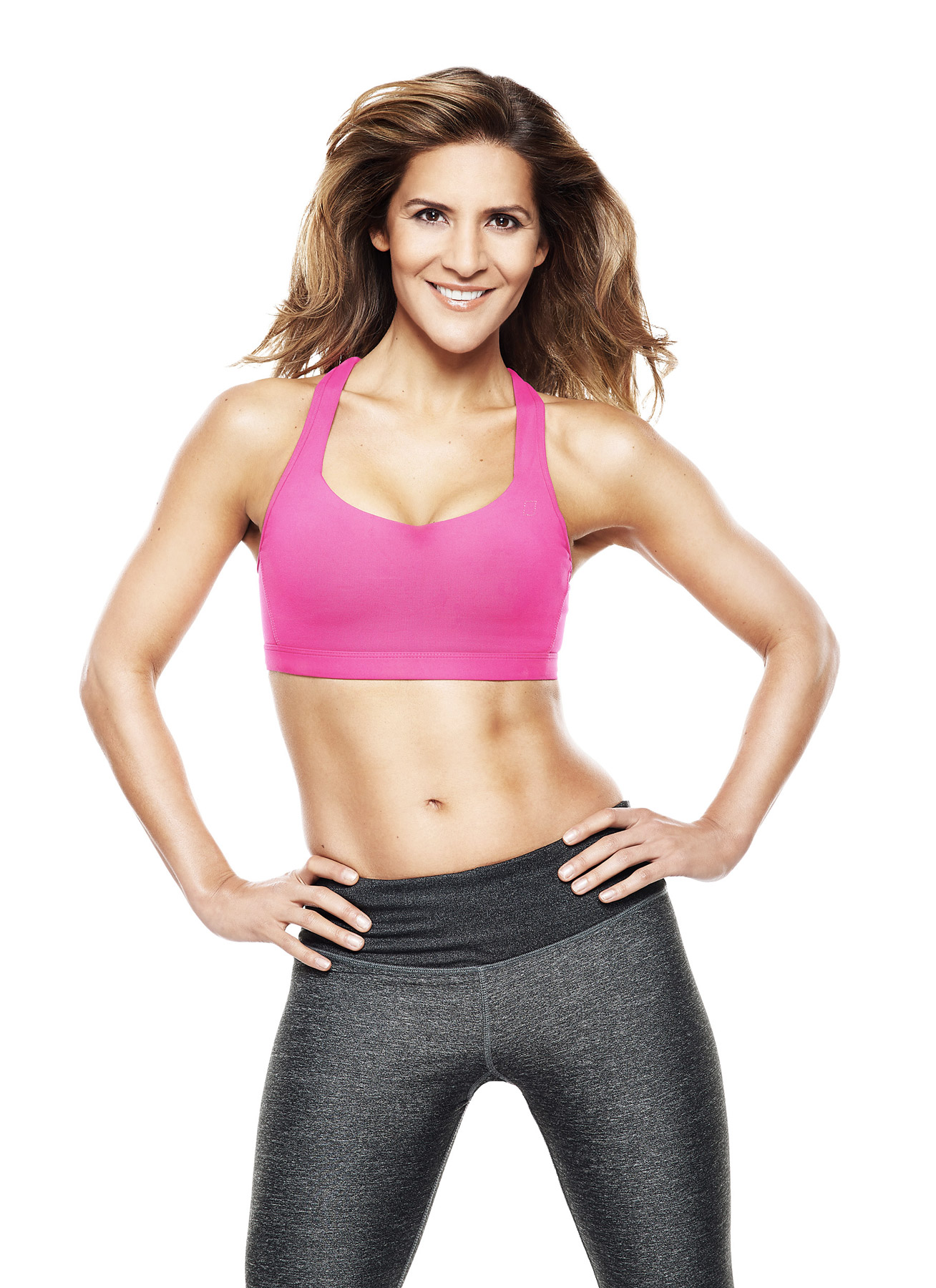 Amanda Byram in sportswear on a white background