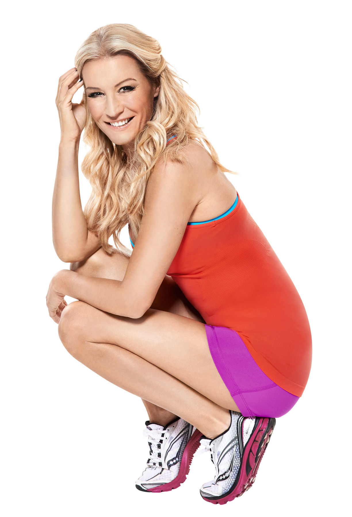 Denise Van Outen crouching on a white background, photographed for Bodyfit magazine