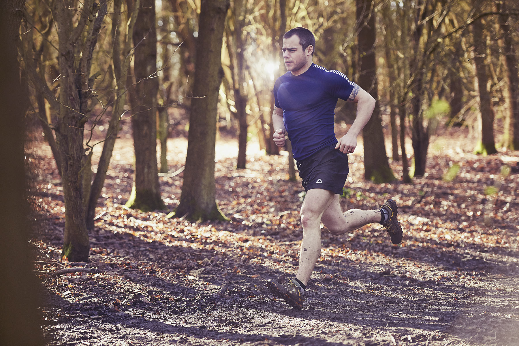 Man running through an Autumnal forest
