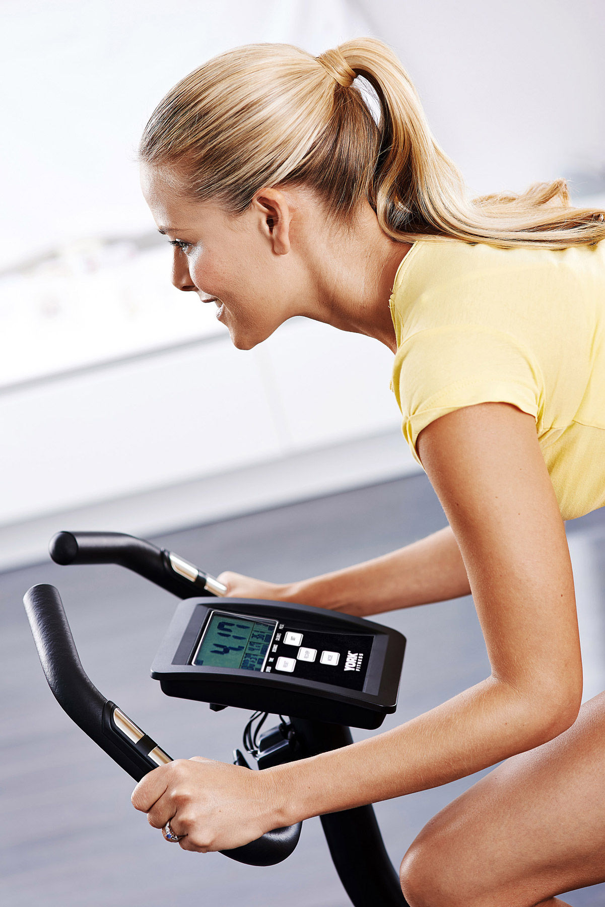 Close up of a woman on a York Fitness exercise bike