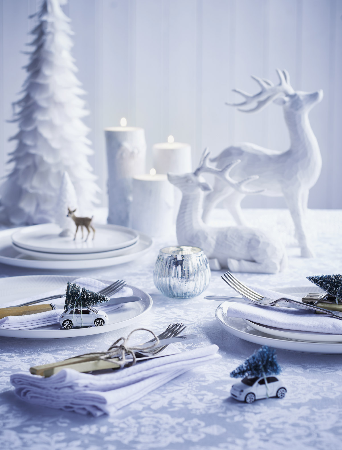 Christmas table setting with little cars