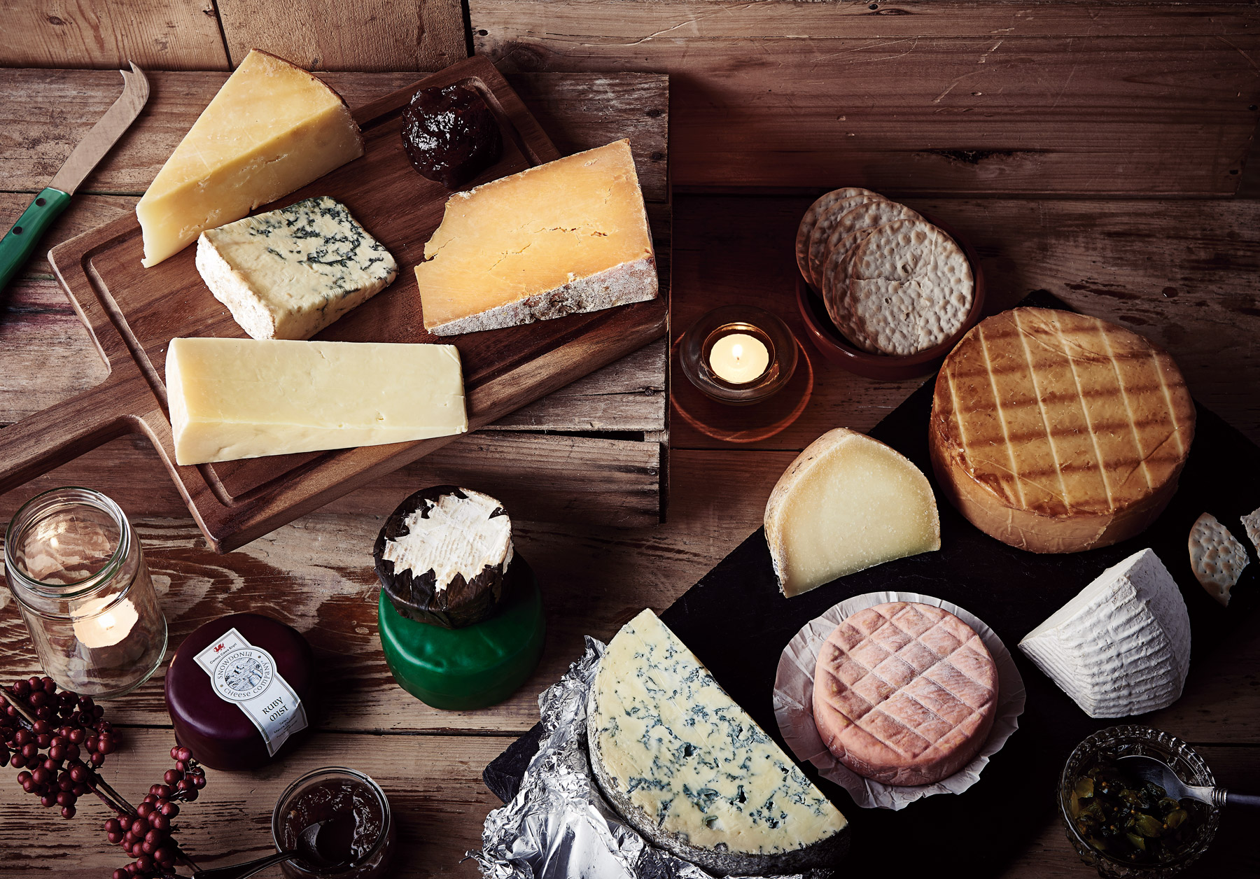 Cheese platter on a wooden background