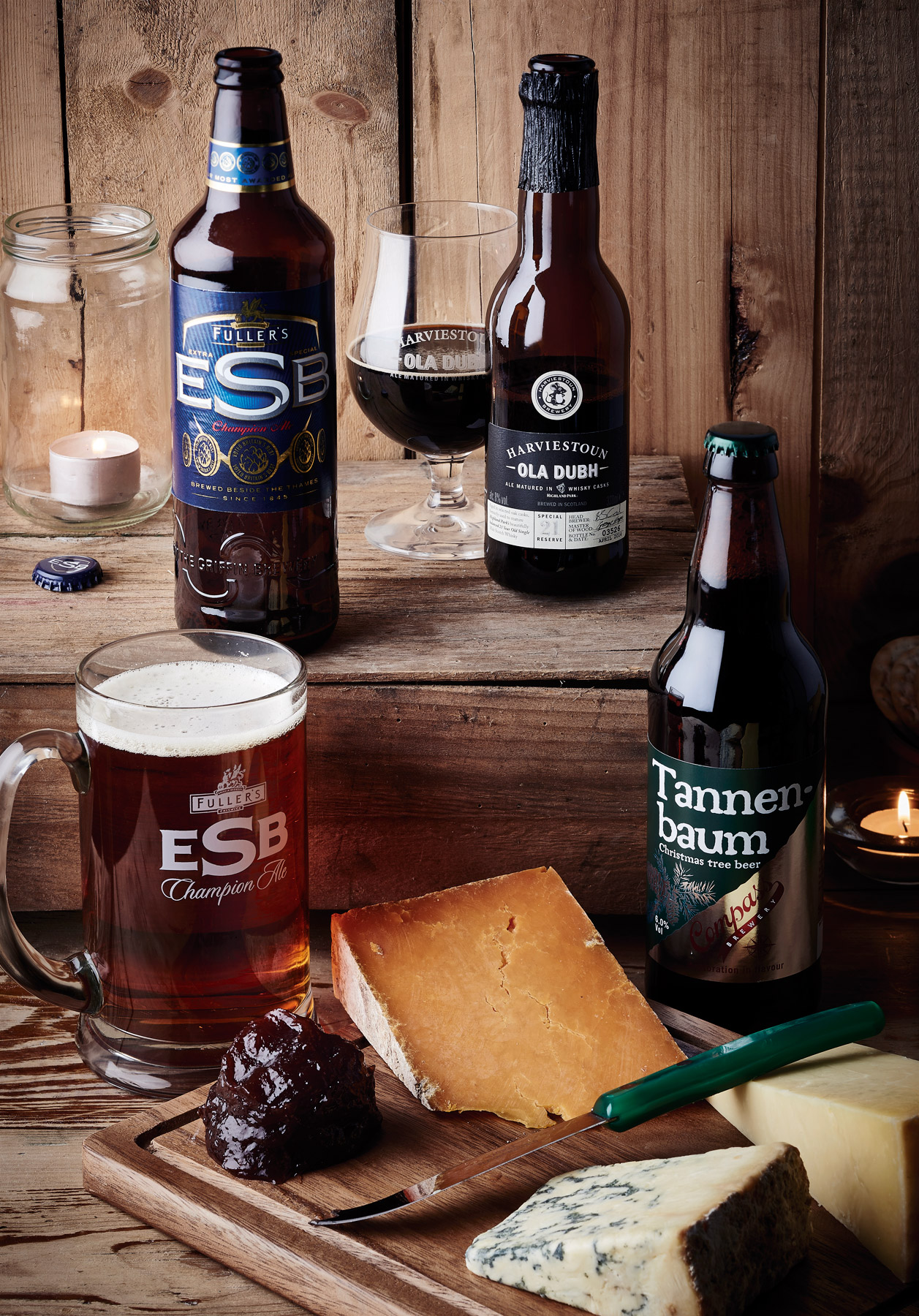 Craft beer selection on a wooden background with cheese