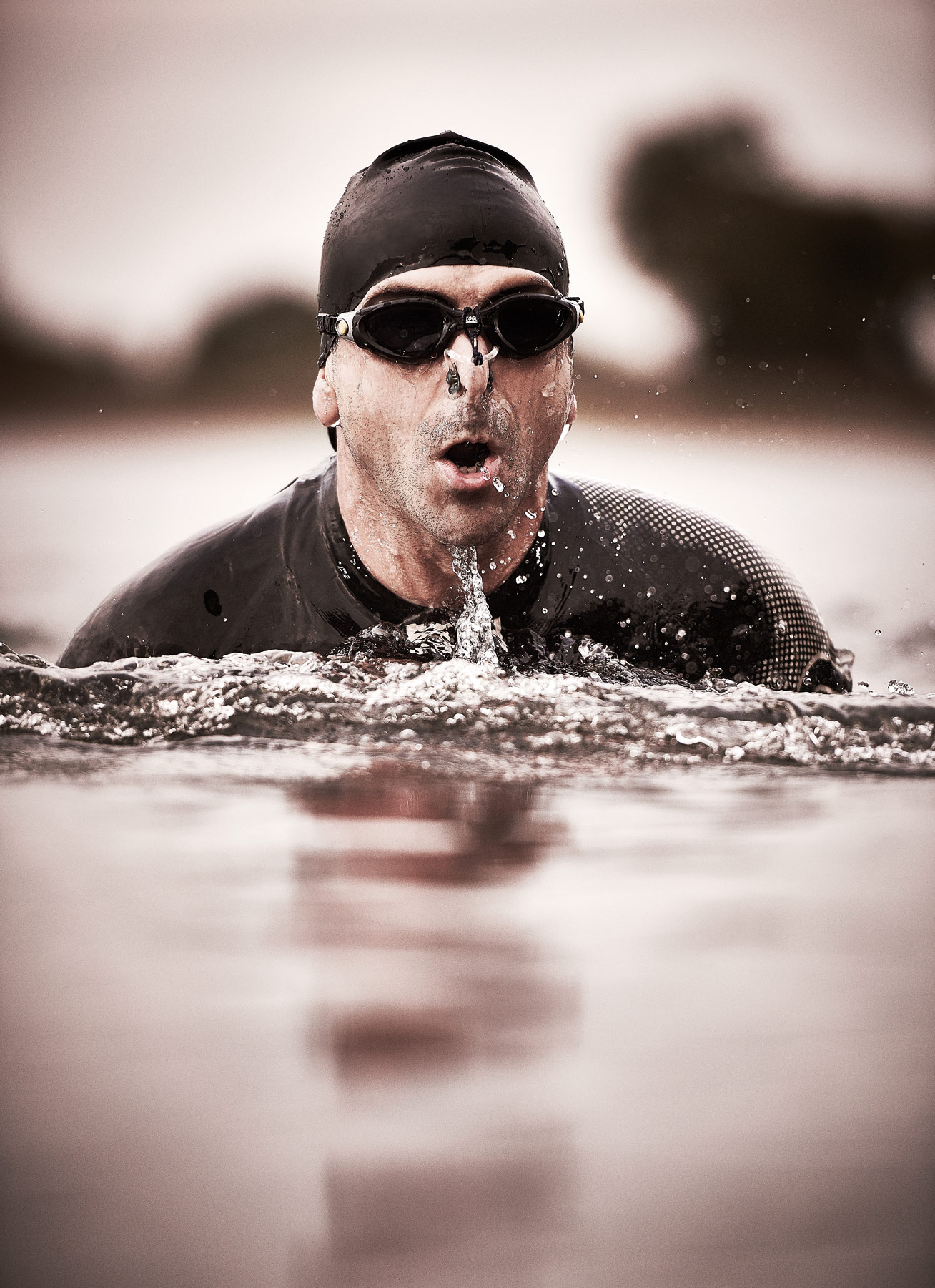 Open water swimming with hat and goggles