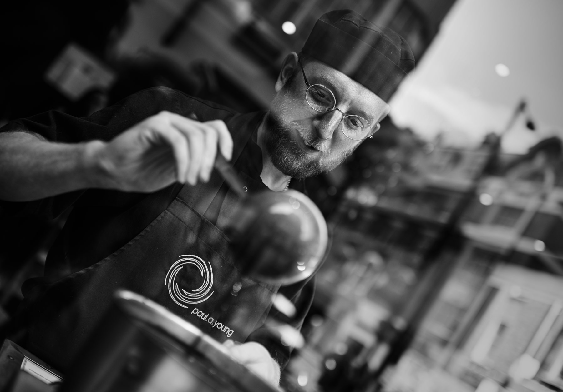Paul A Young pouring chocolate in the window of his Soho boutique