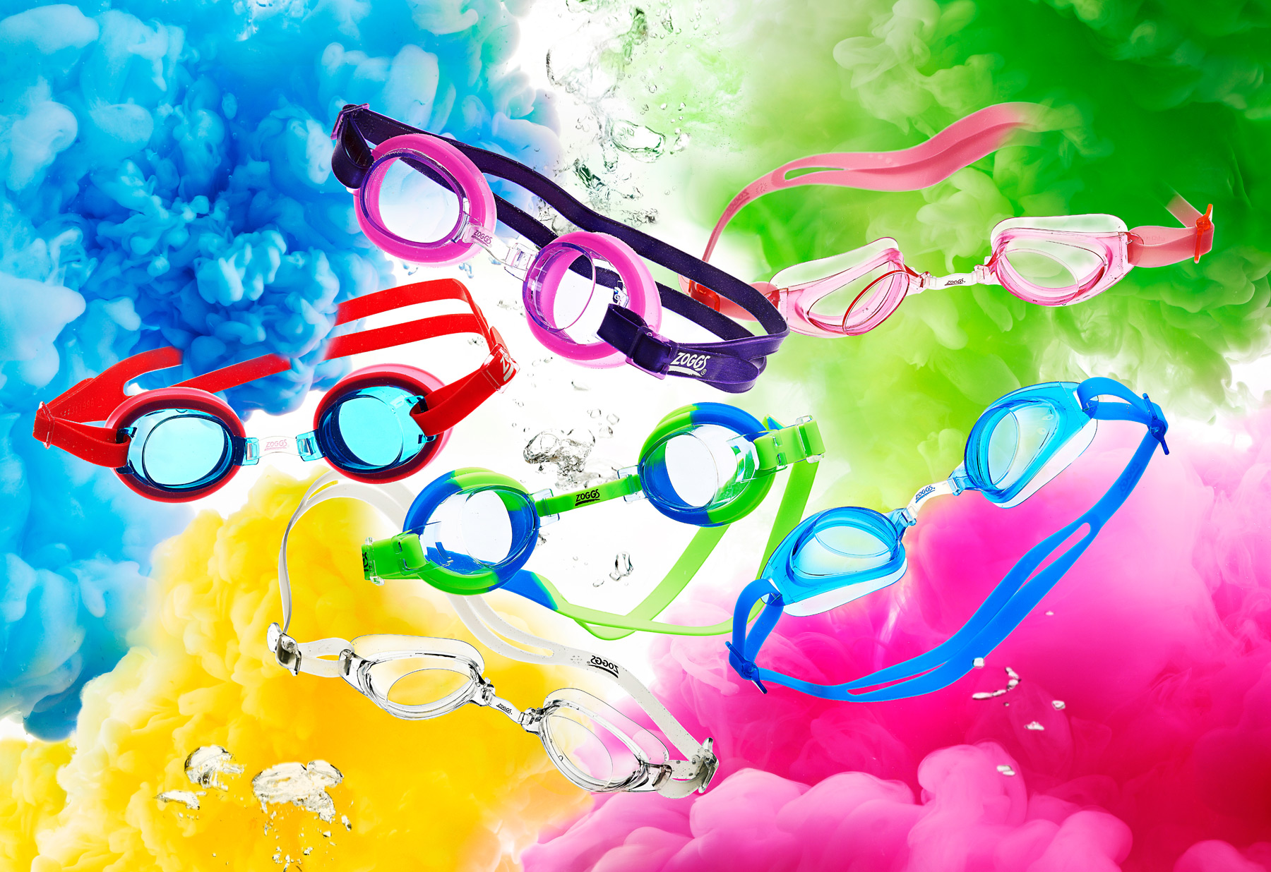 Zoggs children's goggles range underwater with coloured paint clouds