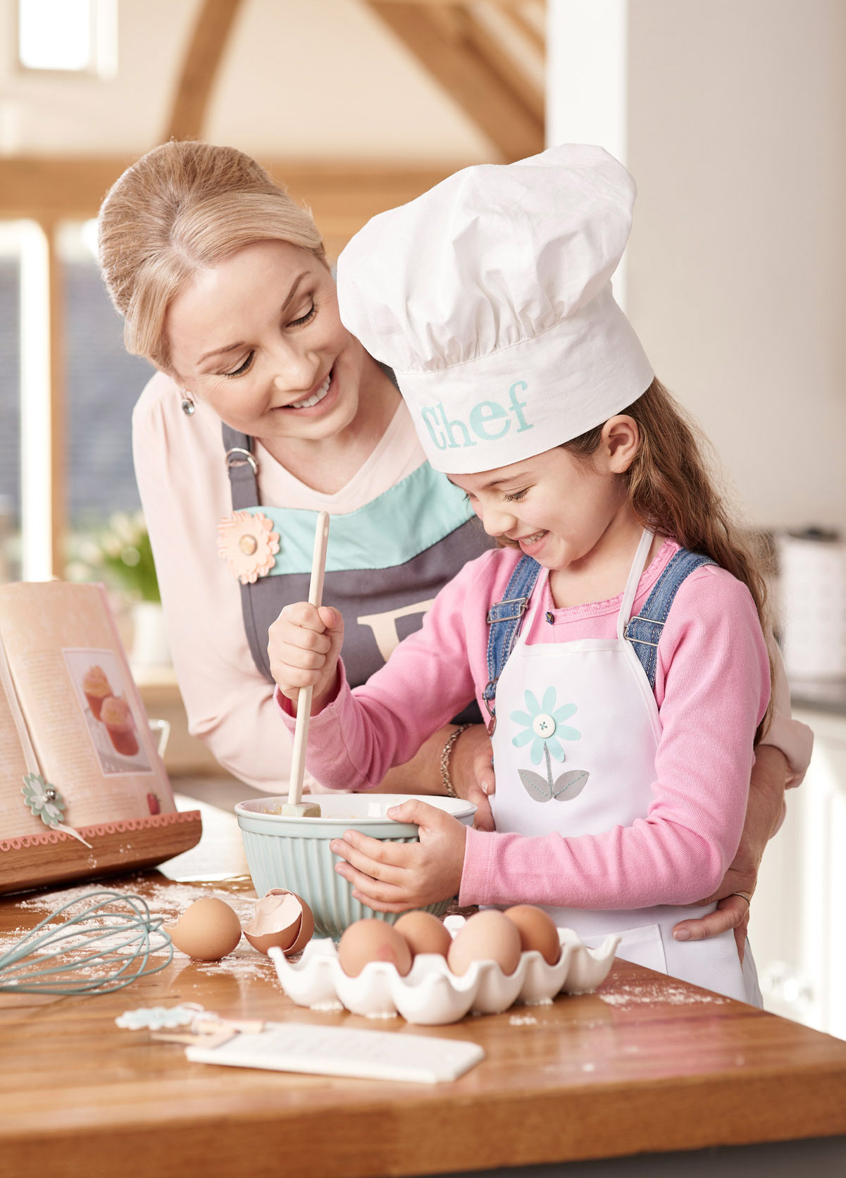 A mum baking with her young daughter