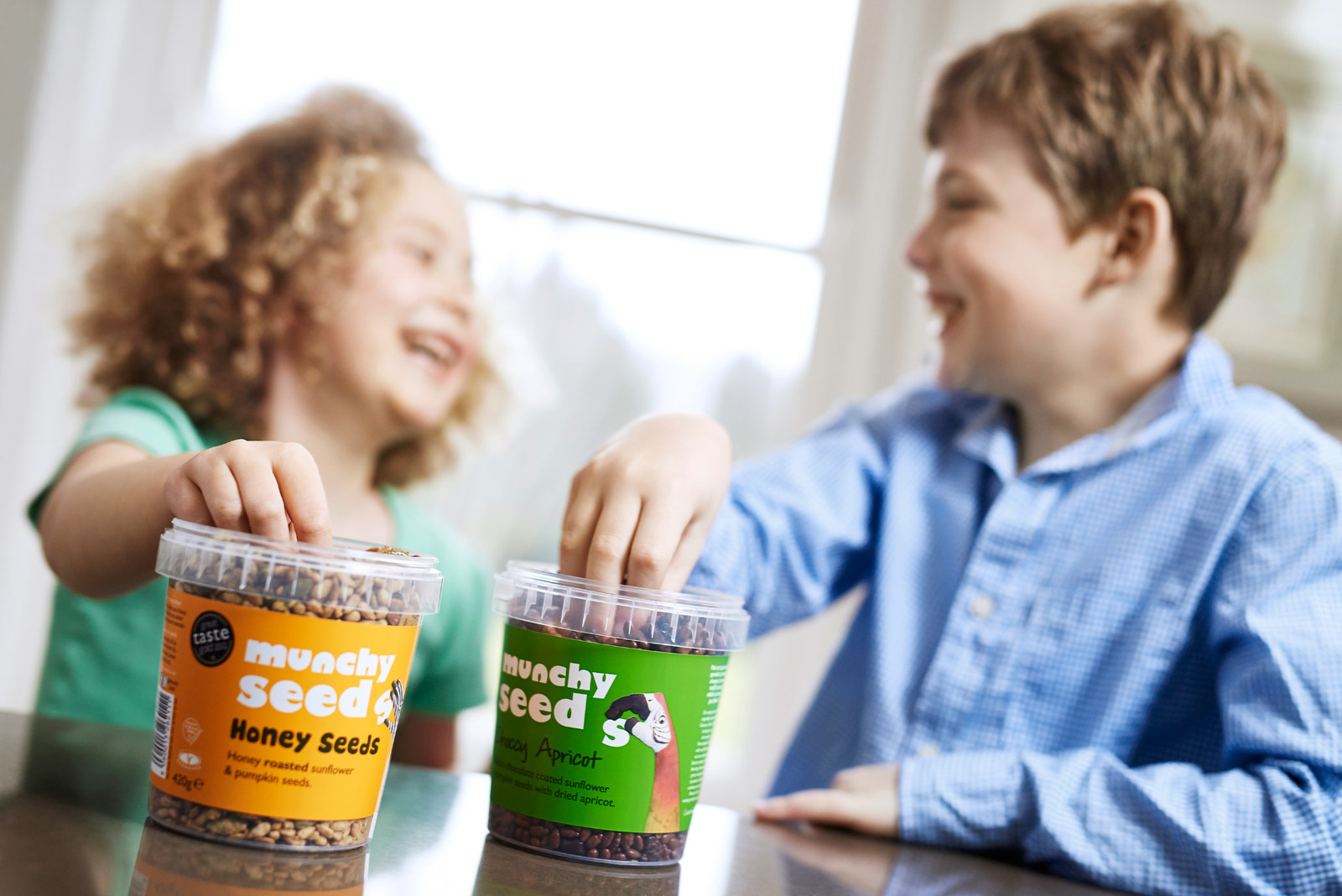 Kids tucking into tubs of Munchy Seeds