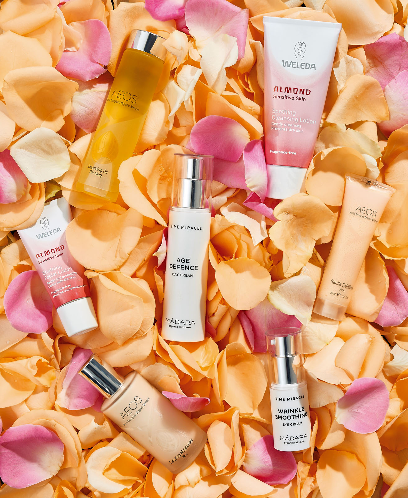 Beauty products photographed on rose petals