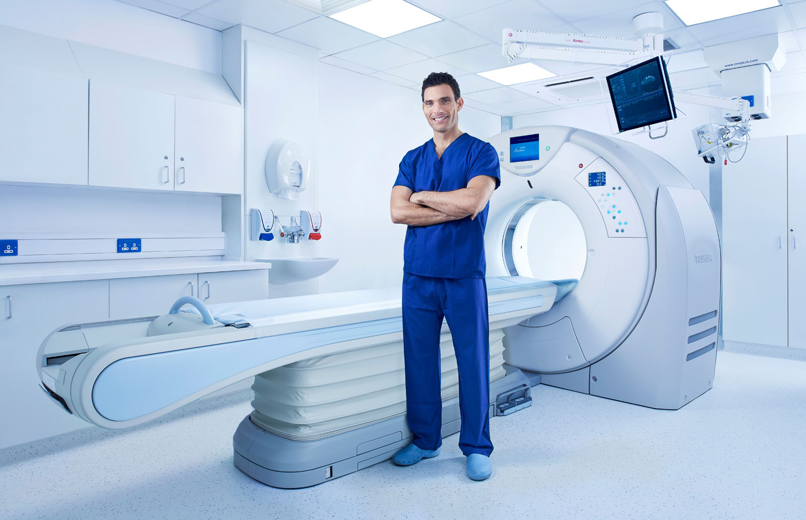 Doctor with a CT scanner