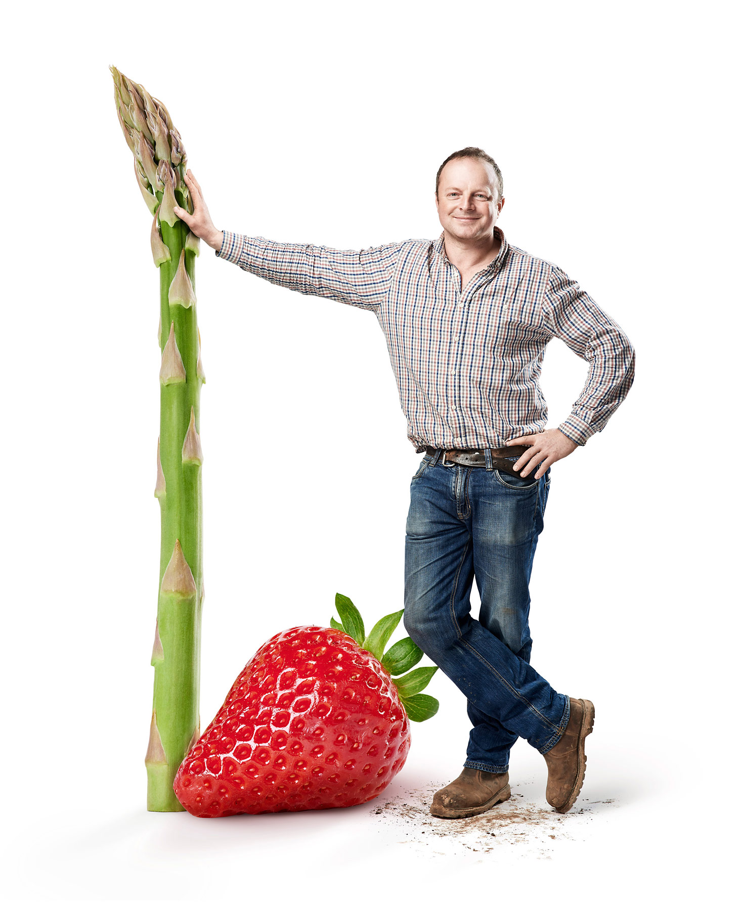 Charlie Tacon with a giant asparagus and strawberry