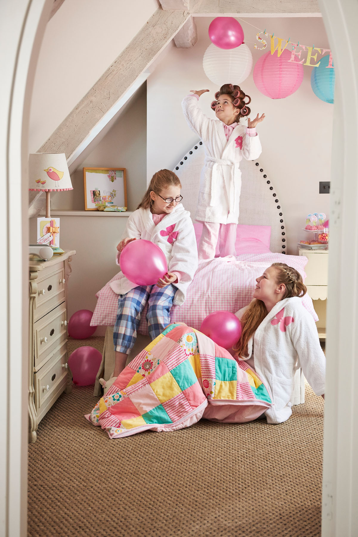 Sisters playing in their bedroom