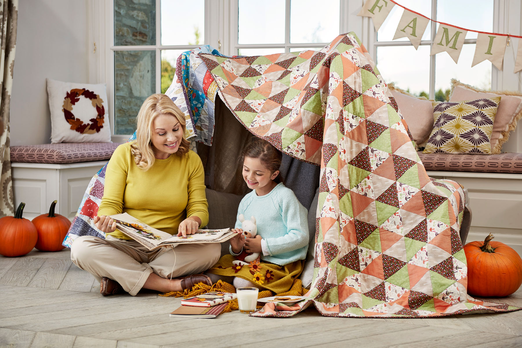 Mother and daughter in a homemade den