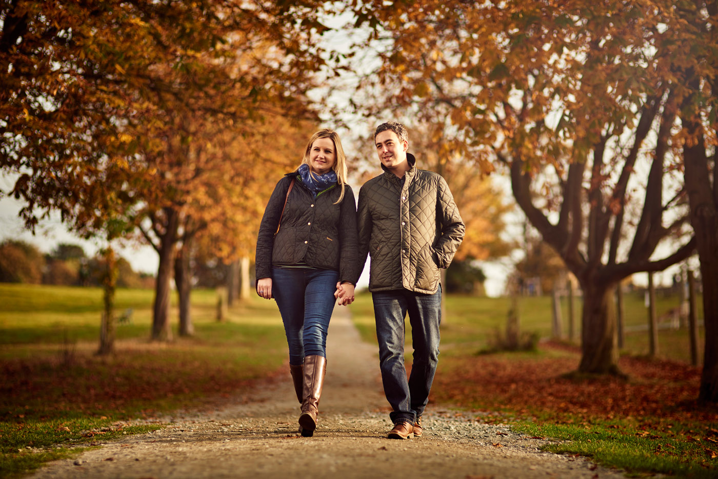 A young couple walking at Weald Park, Essex