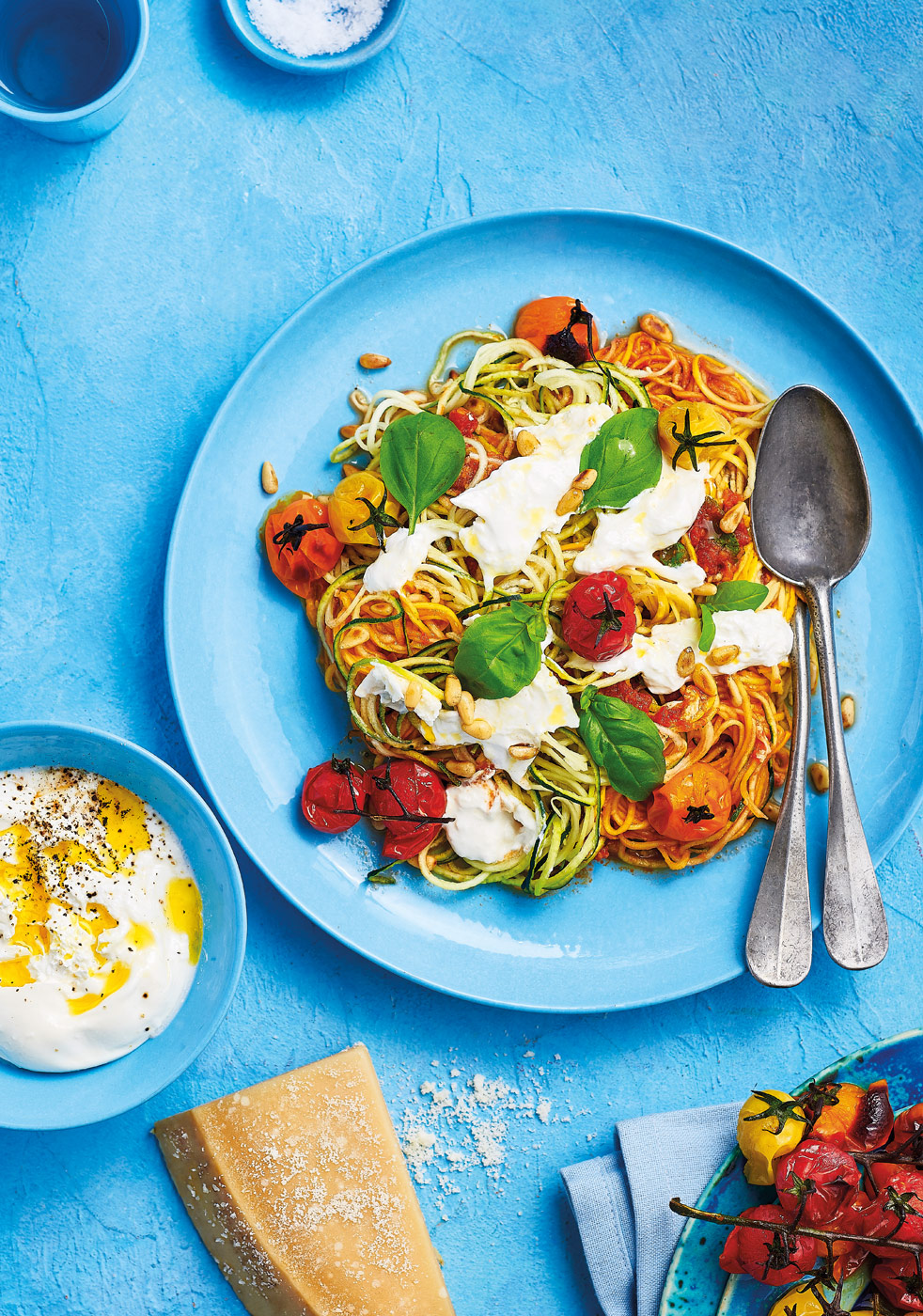 Rainbow courgetti and tomatoes with buratta