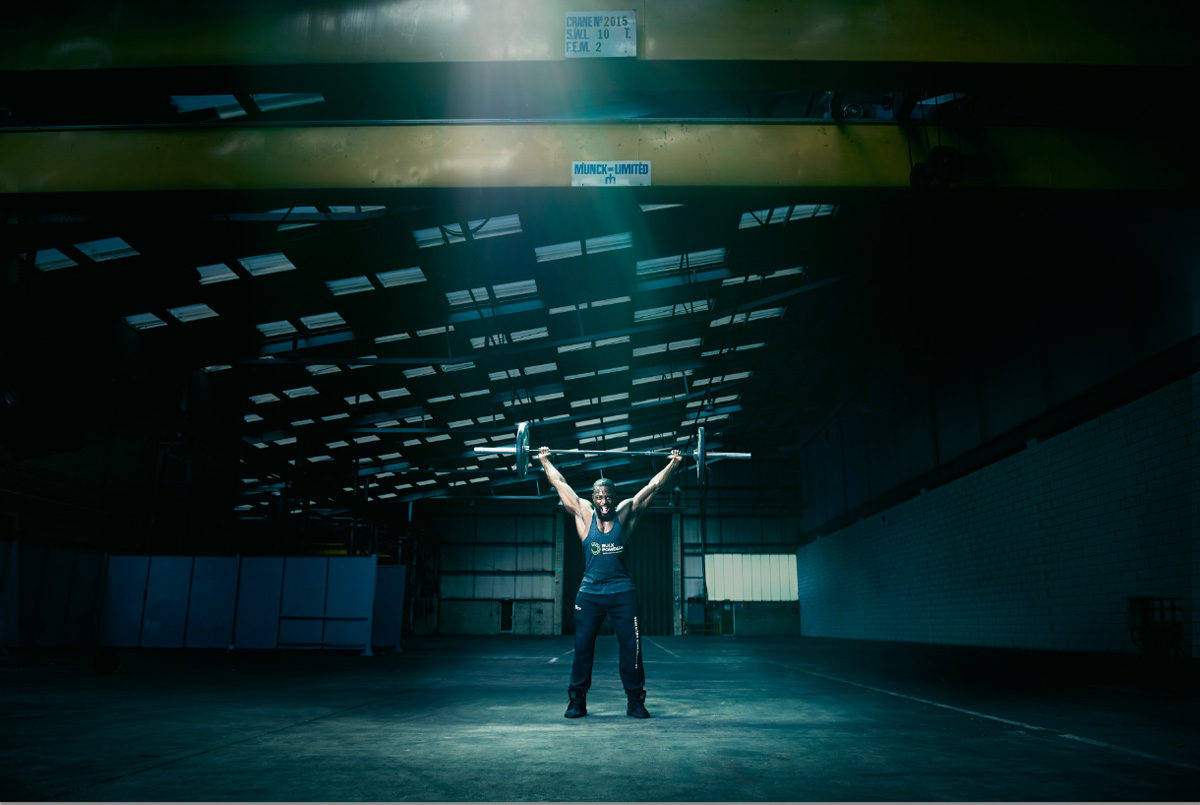 Warehouse weightlifting photoshoot