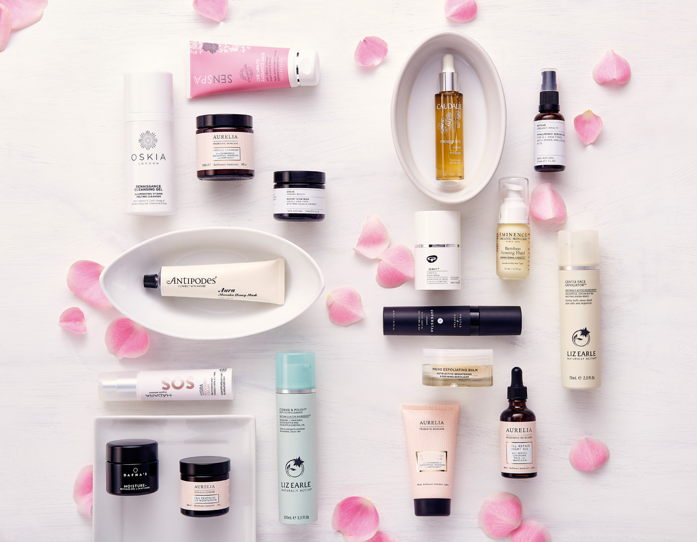 Large double page shot of womens beauty products from overhead