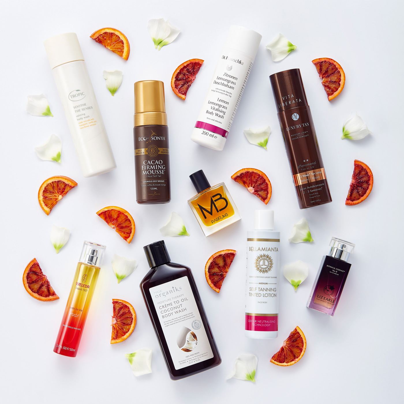 Beauty products photographed with orange segments