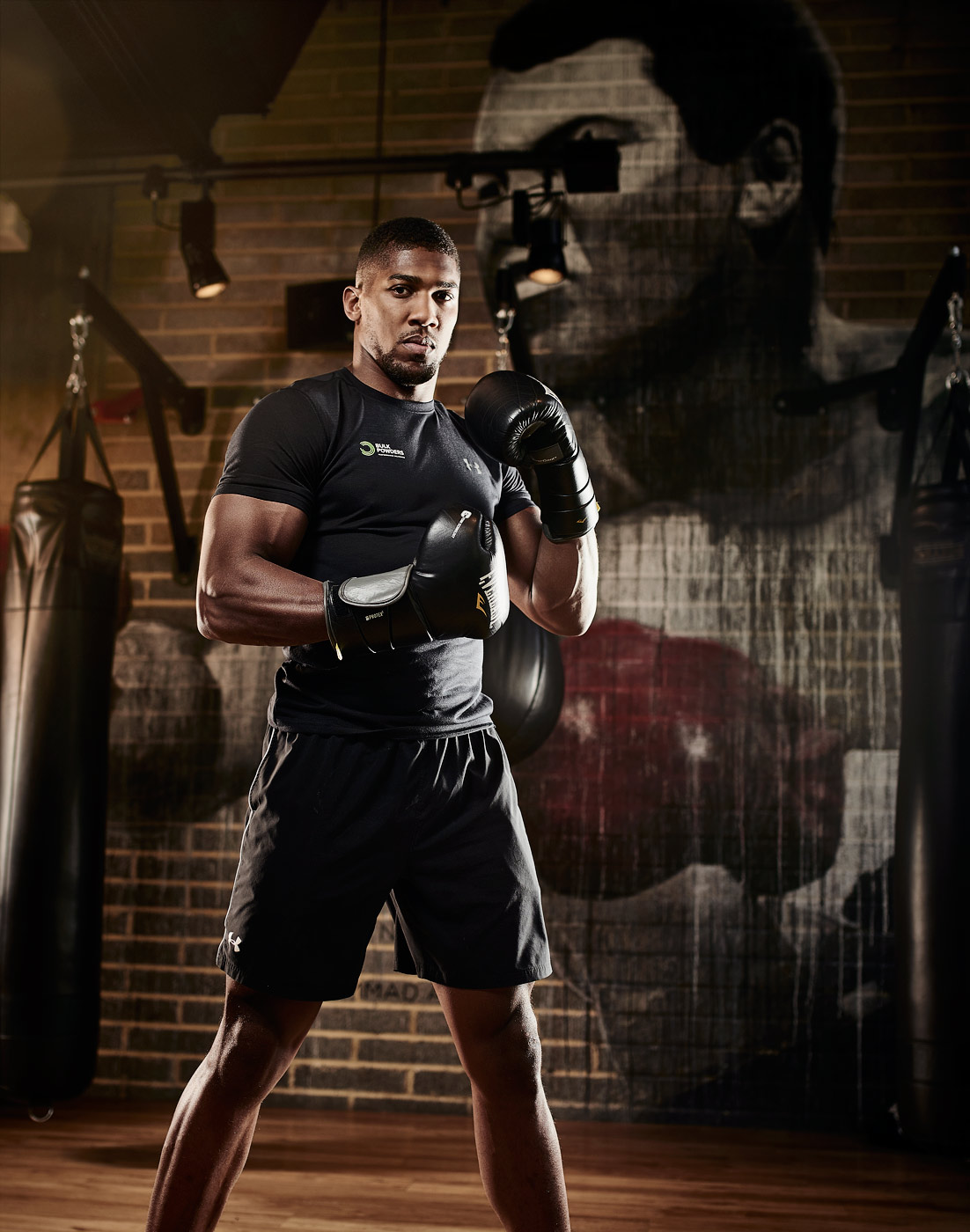 Anthony Joshua with boxing gloves on