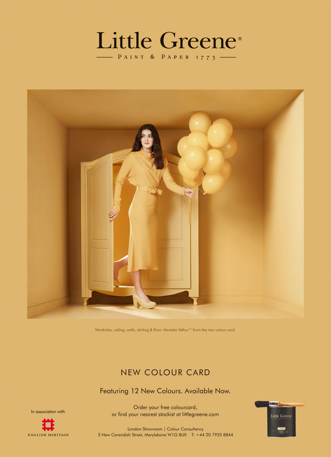 Model holding yellow balloons for a paint advert