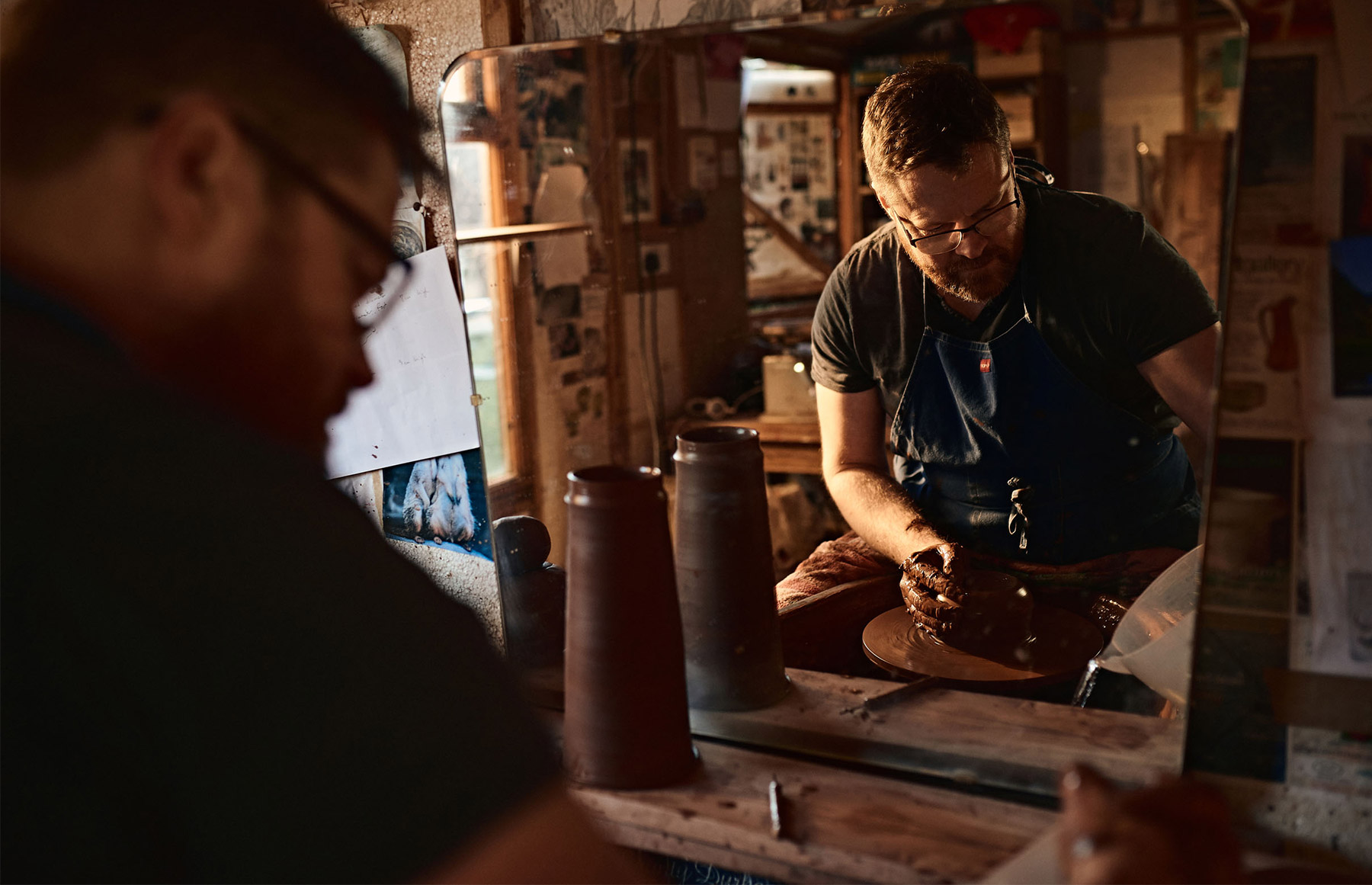 Neville Tatham creating a jug on the wheel in his studio