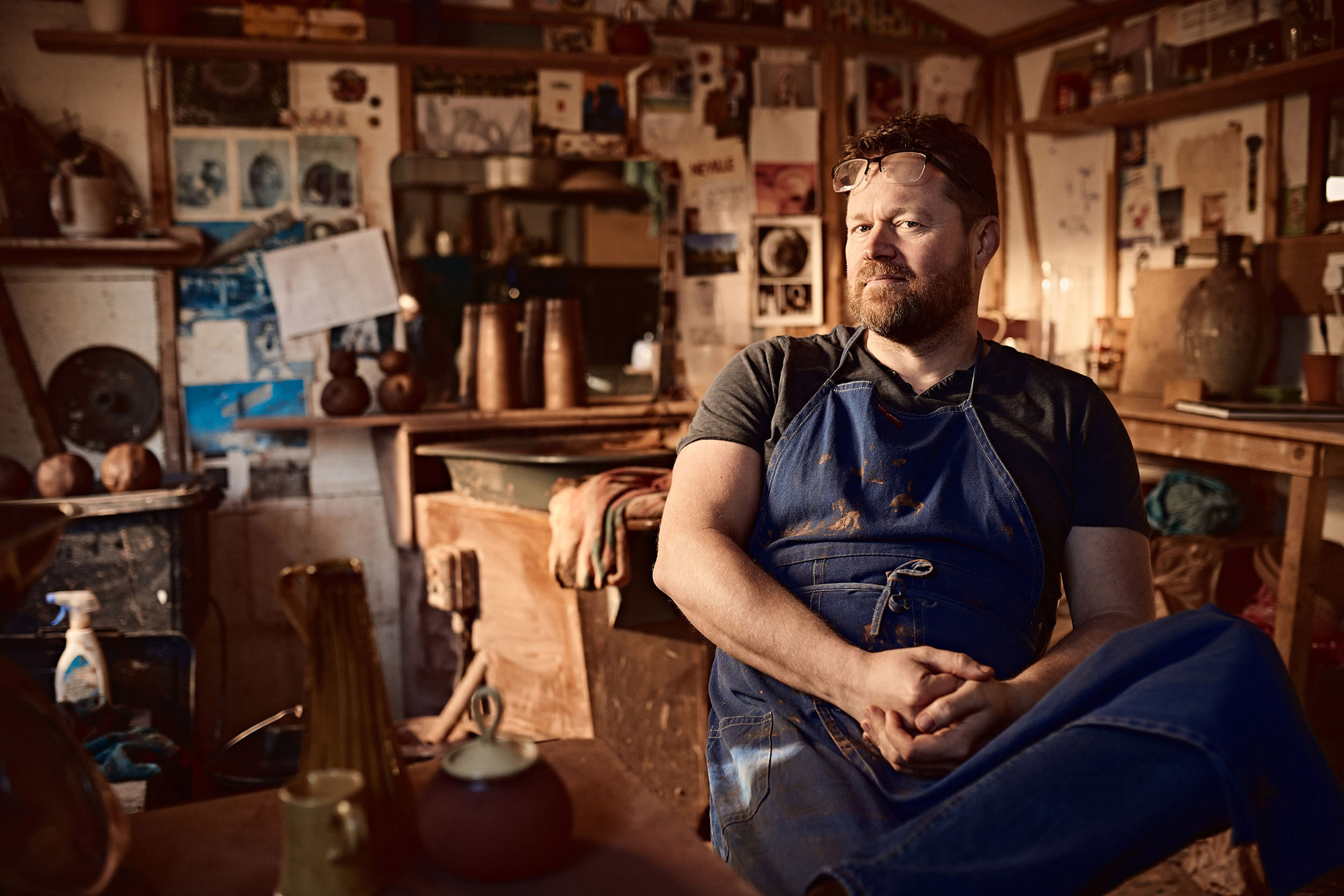 Portrait of artist Neville Tatham in his garden studio