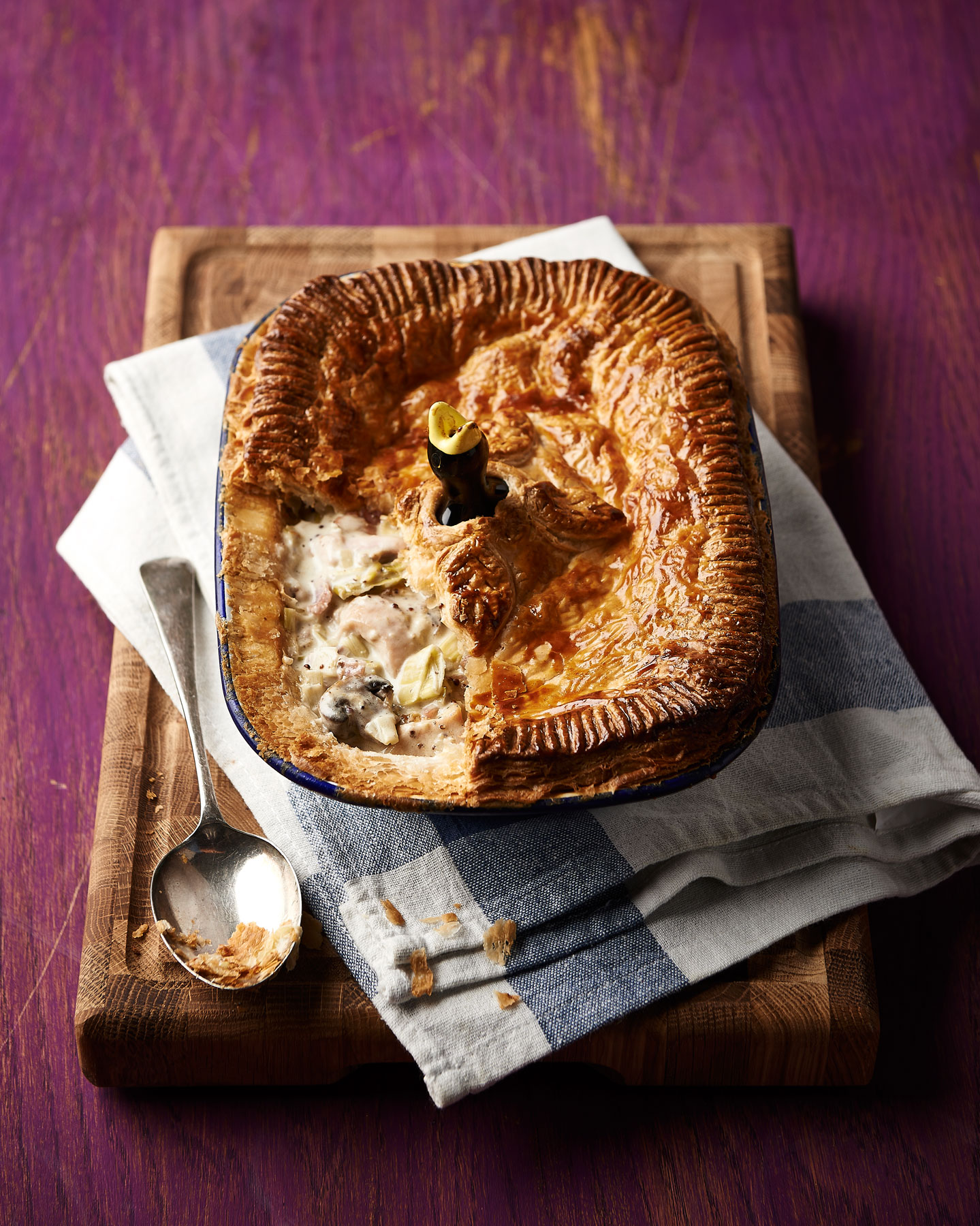 Chicken and leek pie on a purple background