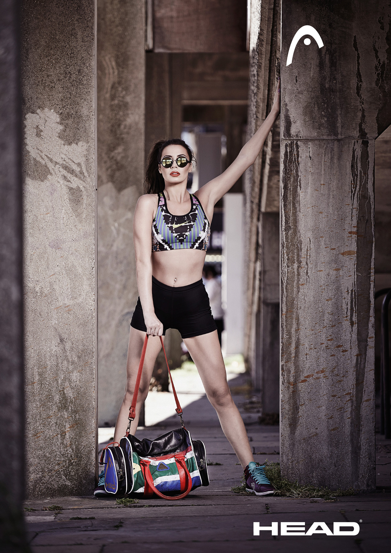 Girl modeling a Head bag in a gritty urban space