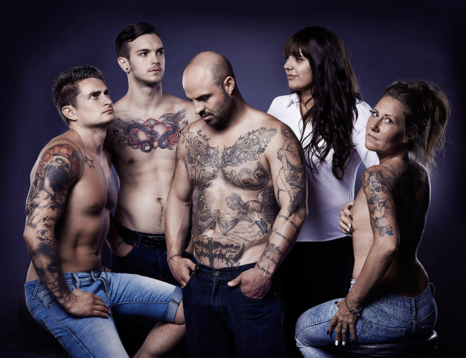 Group shot showing the team and their tattoos