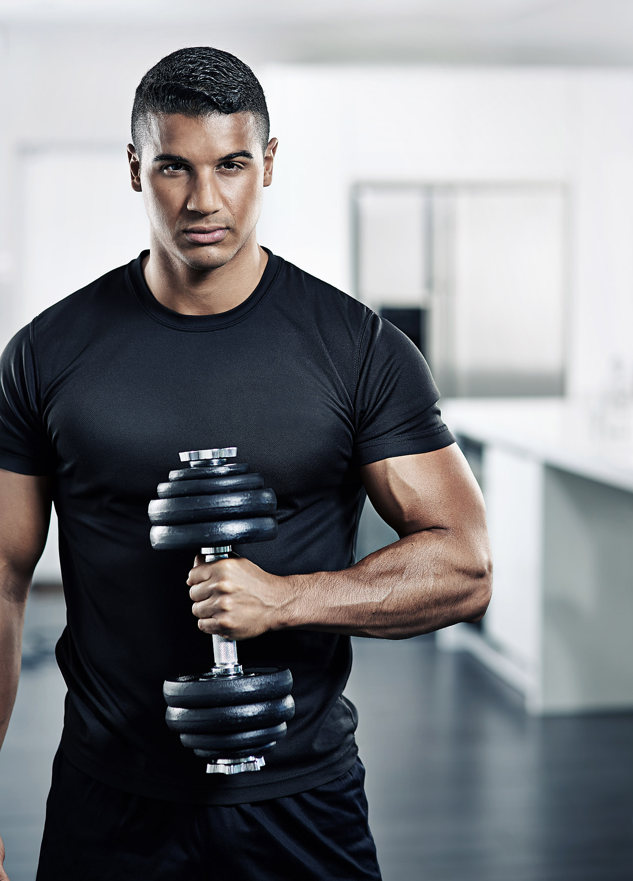 Muscular man holding a York dumbell