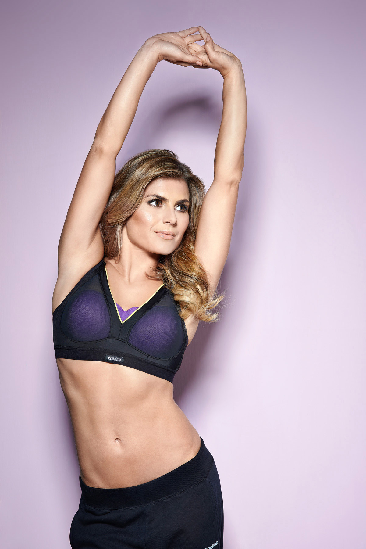 Zoe Hardman in sportswear on a pink background