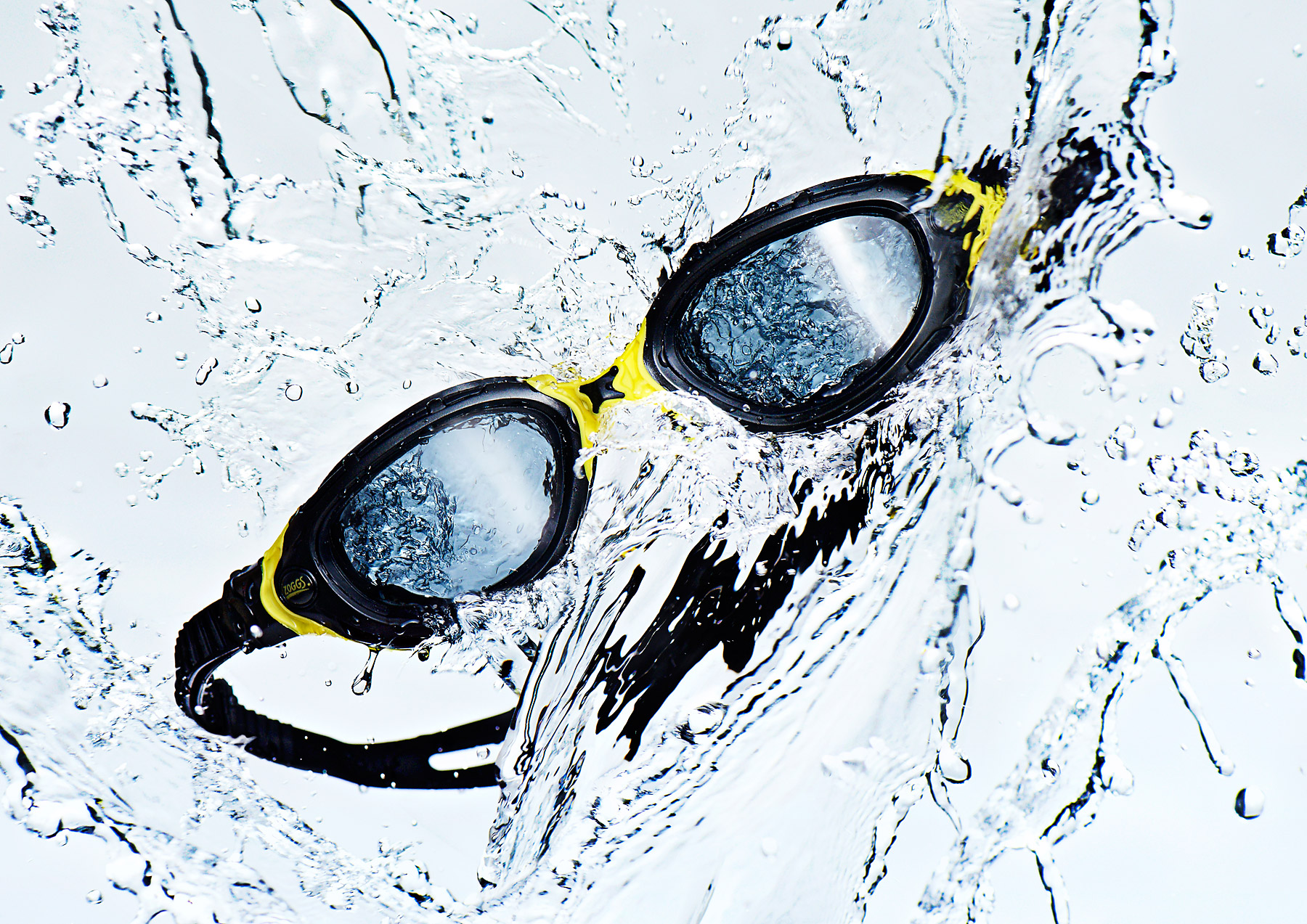 Zoggs swimming goggles falling through splashing water