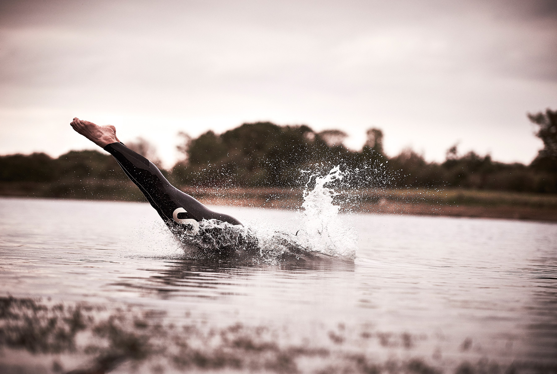A man dives into open water