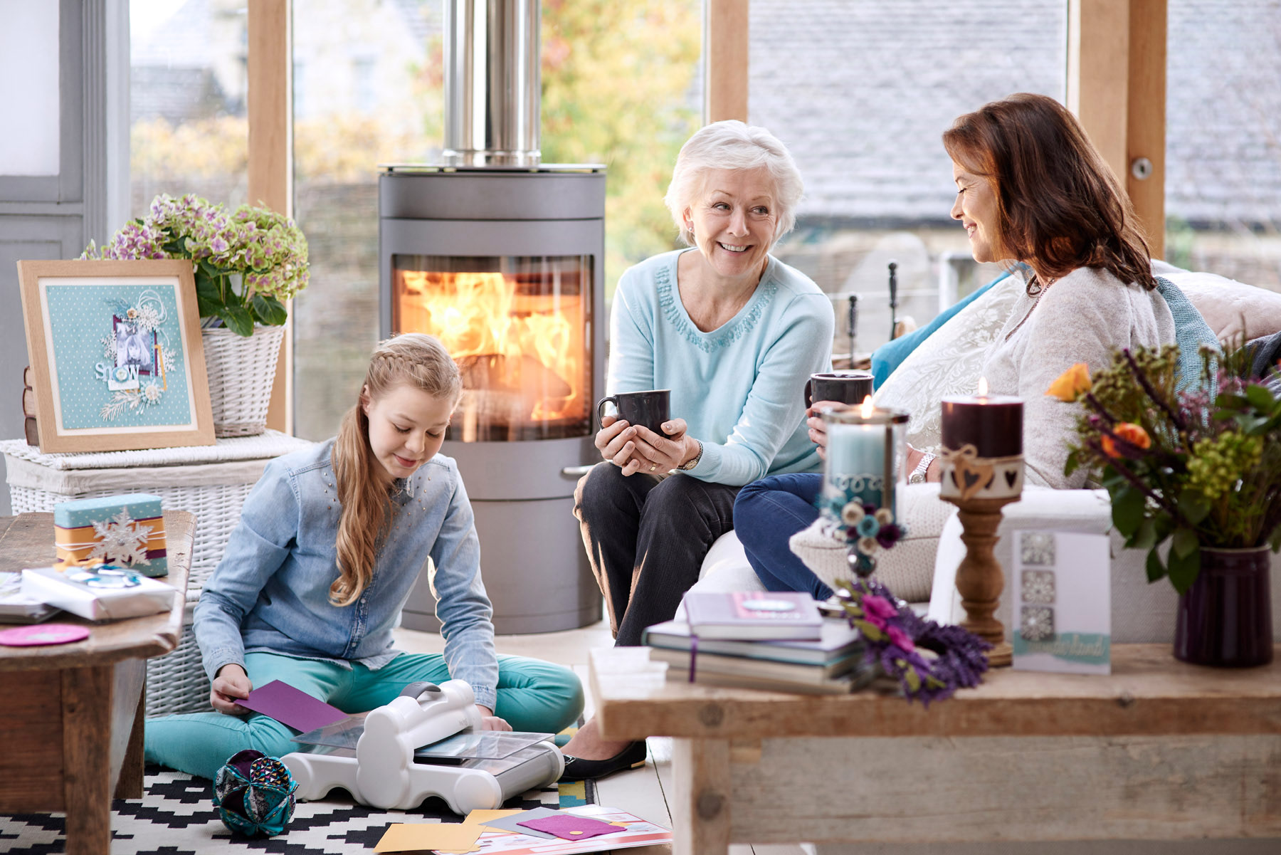 A family sitting by the fire in the living room