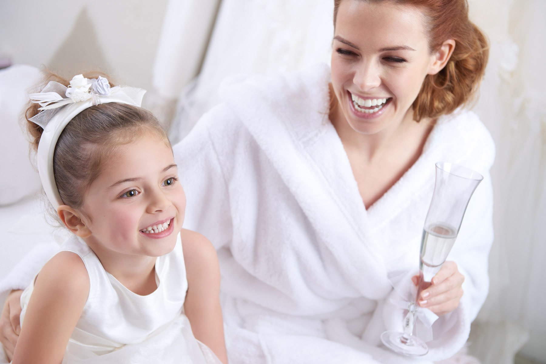A girl and her young sister getting ready on her wedding day