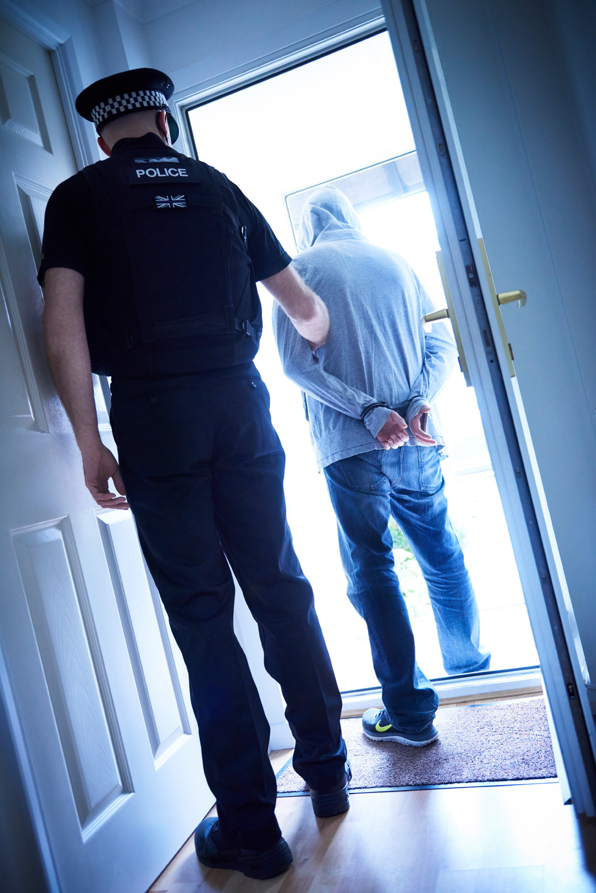 A police officer arrests a suspect