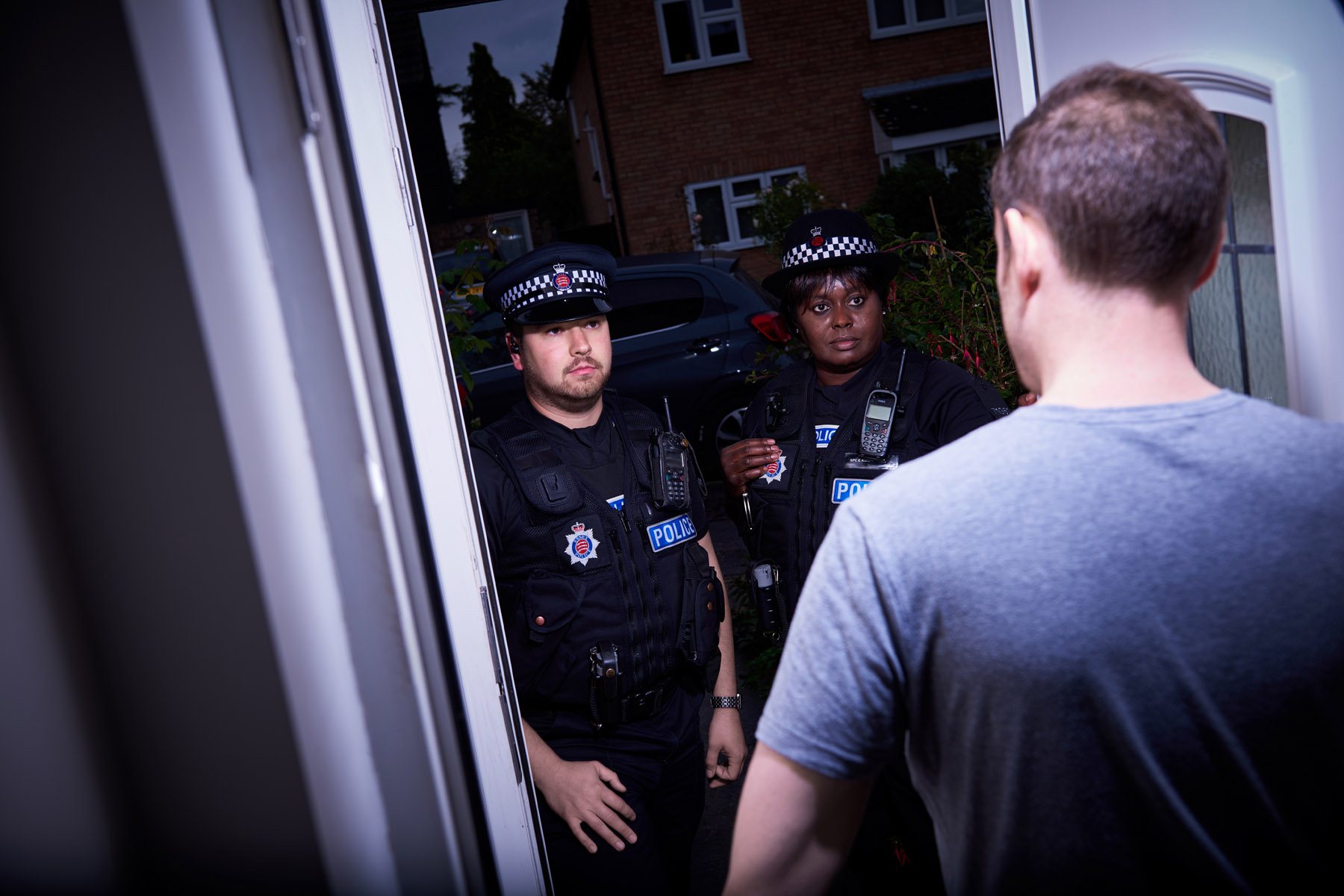 Policer arrive at a house