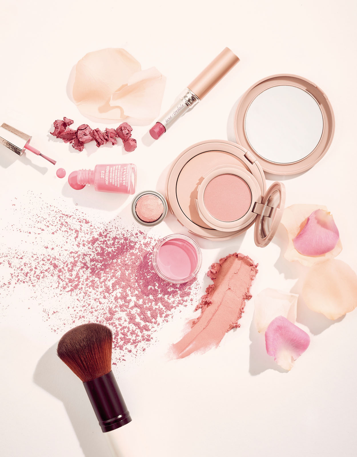 Beauty products on a pink background
