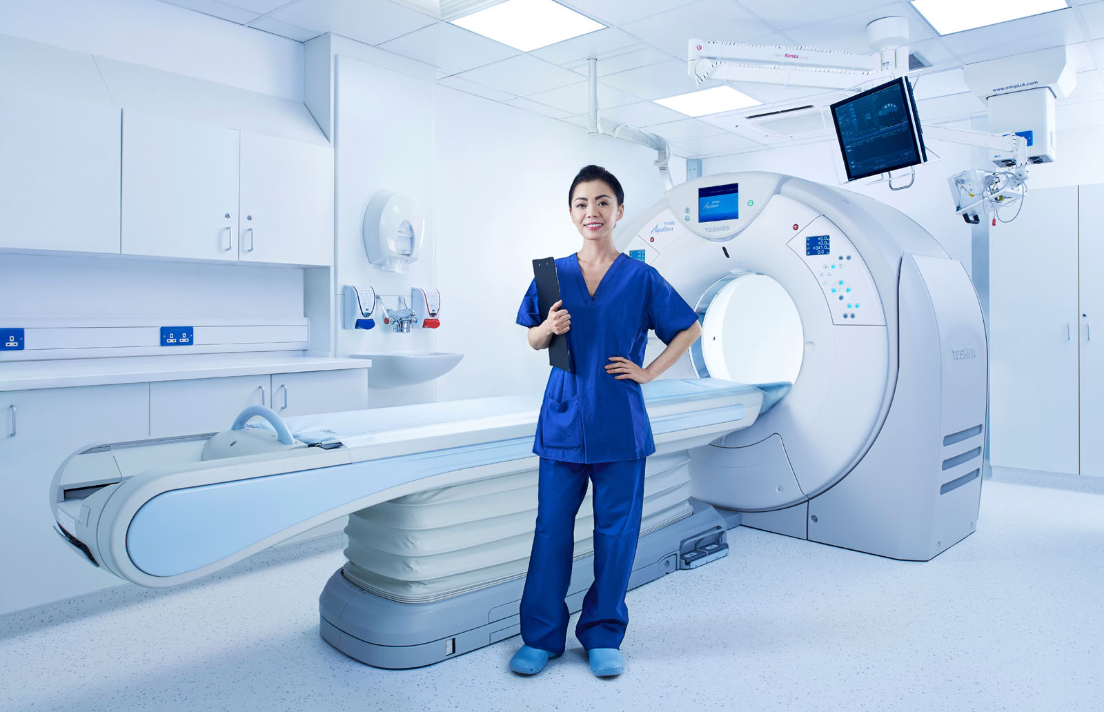 Technician in front of a CT Scanner