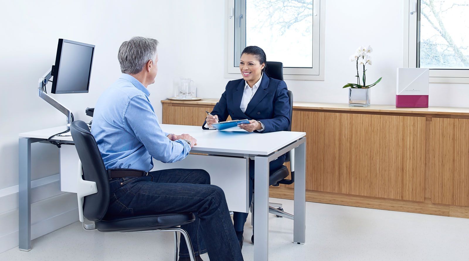 Patient and consultant in an office