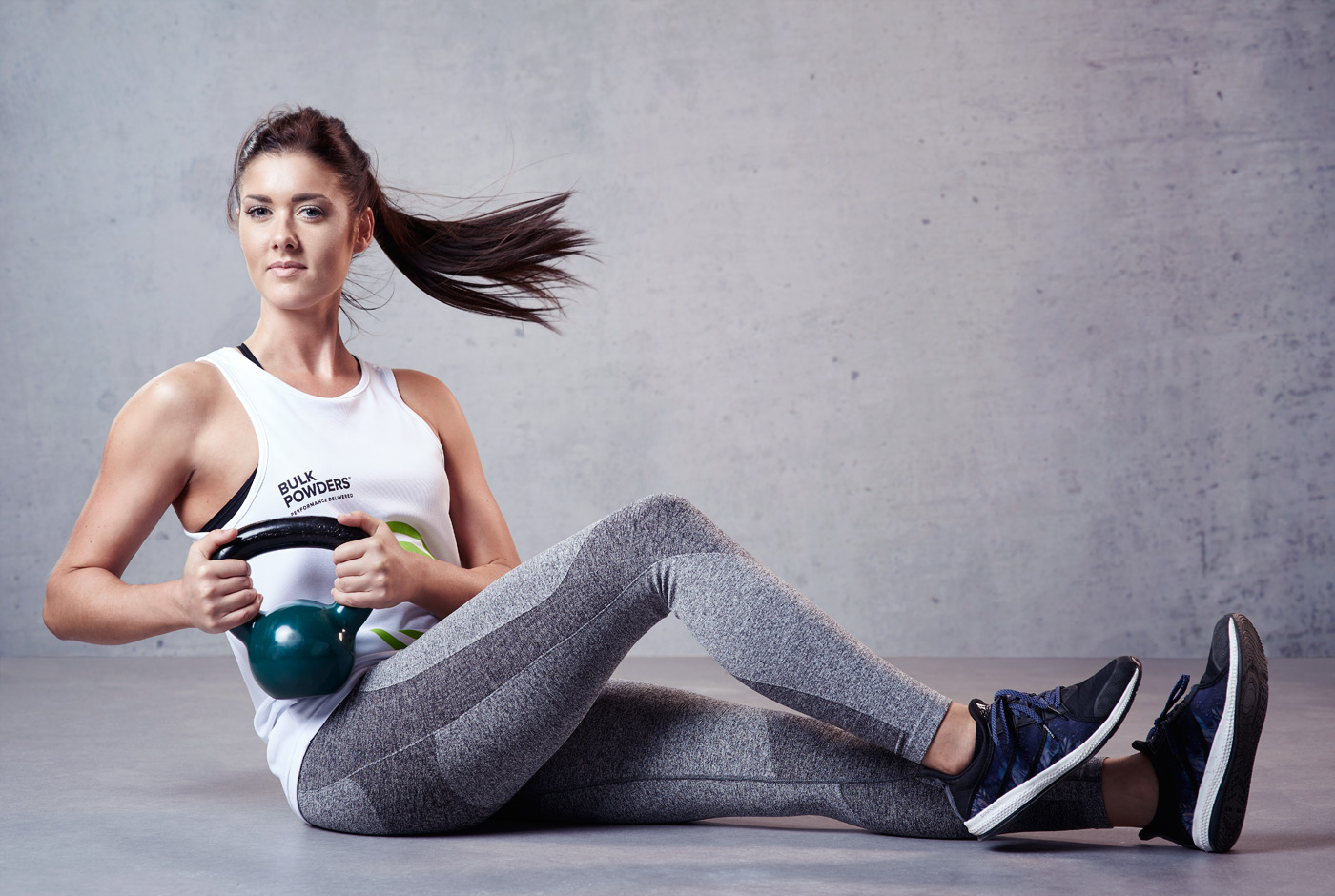 Female athlete working out with a kettlebell