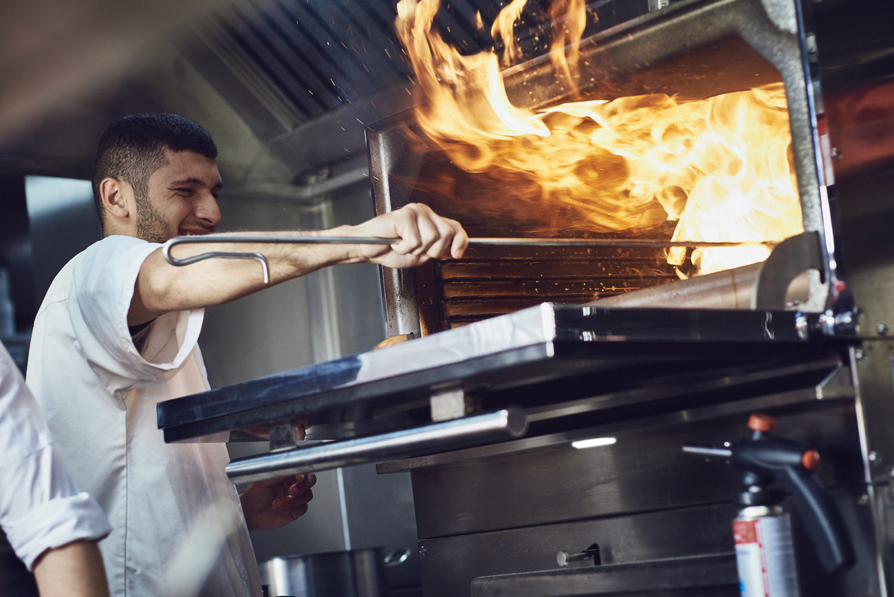 Flames from the over in a commercial kitchen