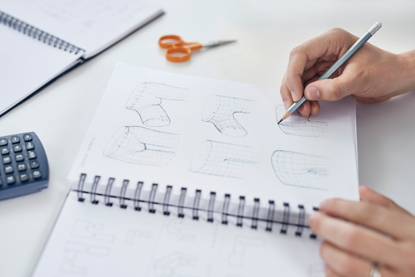 Designer working on product design sketches