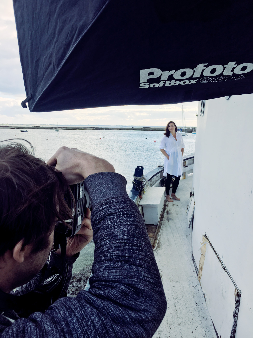 Behind the scenes on a women's fashion shoot on a house boat