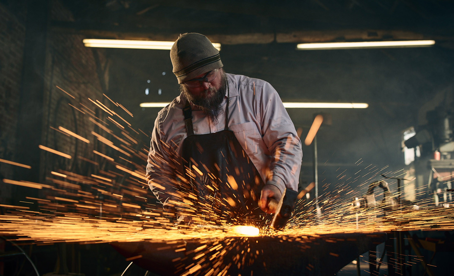 Sparks fly as the blacksmith works