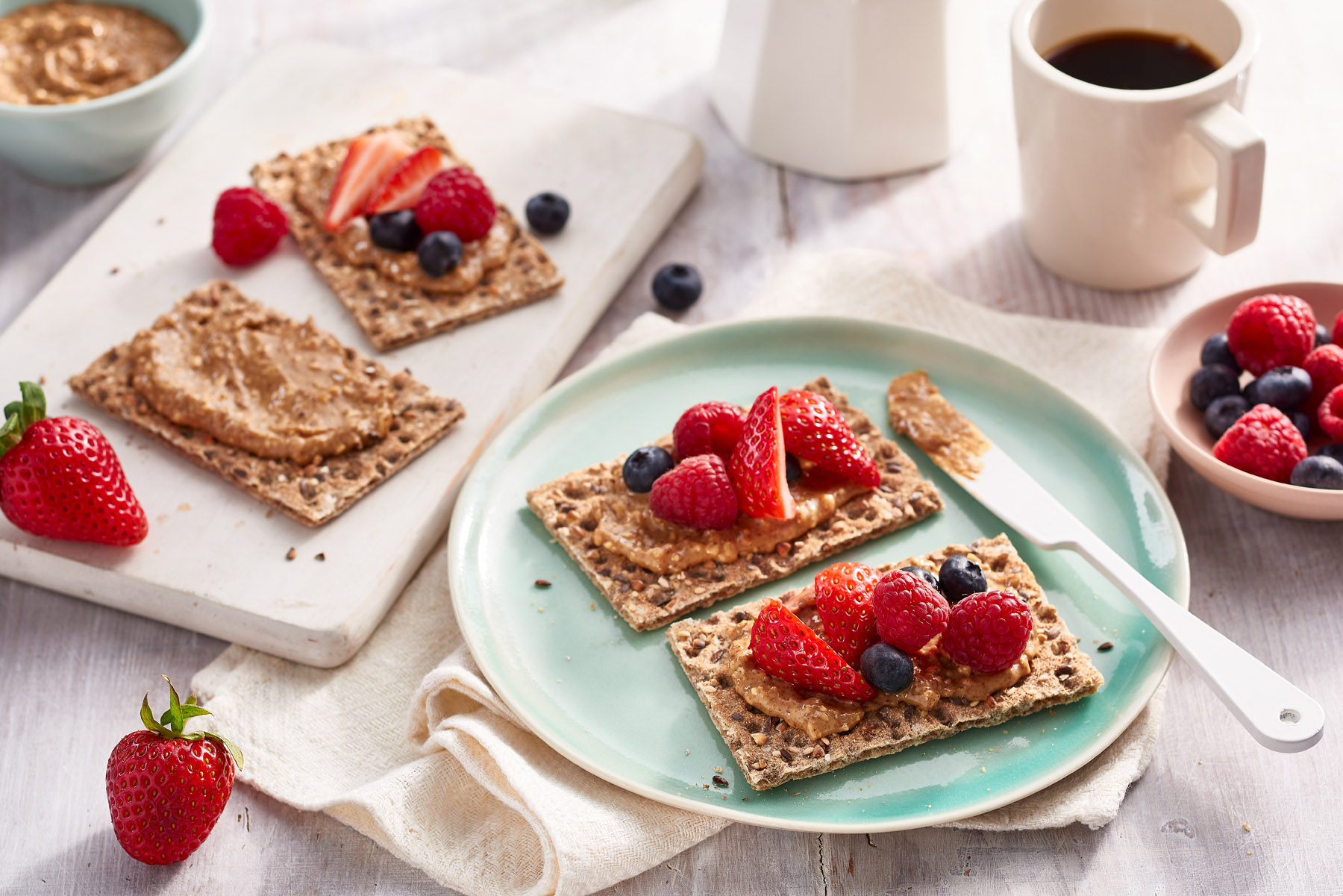 Mixed berries with peanut butter on Ryvita