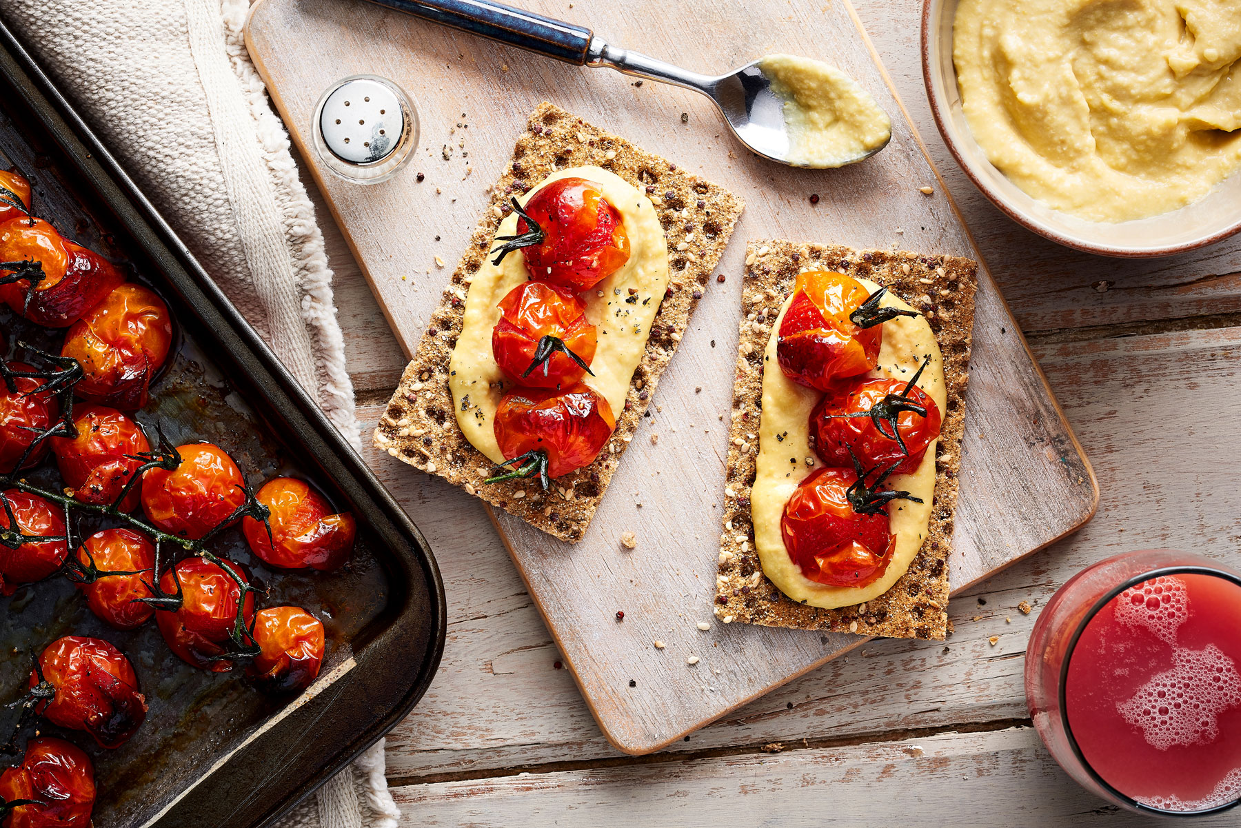 Ryvita with hummus and roasted cherry tomatoes