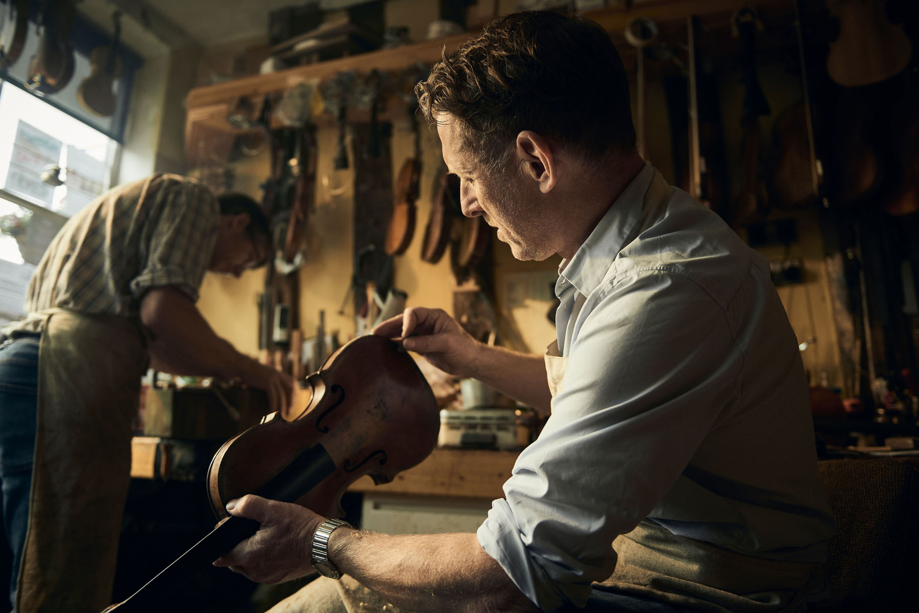Stringed instruments being repaired by craftsmen