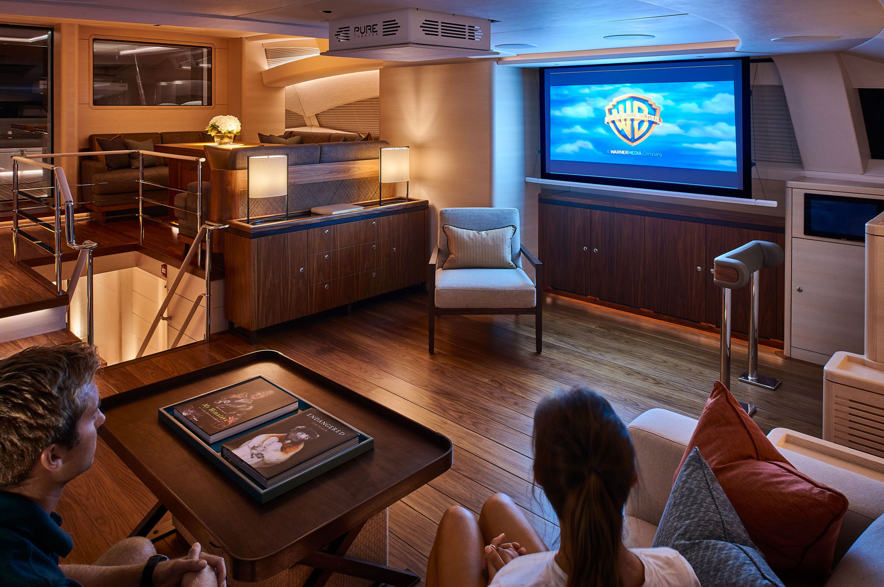 Couple watching a film onboard a super yacht
