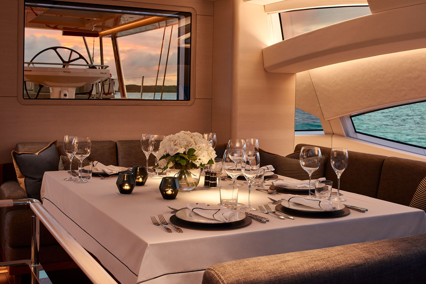 The upper salon of S/Y Archelon set for a formal dinner